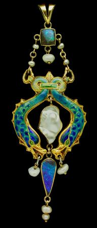 JAMES CROMAR WATT  1862-1940  Arts & Crafts Dolphin Pendant  Enamelled gold with opal & pearl