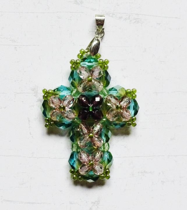 PoWoli / This wonderful cross is was made by Sabina Bugaj. She has used glass beads and fire polished beads to make this little masterpiece. Clasp is in a silver colour.  Perfect not only for religious purposes!  Length: about 4 cm/ 1,6 inches