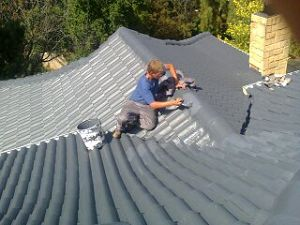 Painting of Tile Roof after waterproofing.
