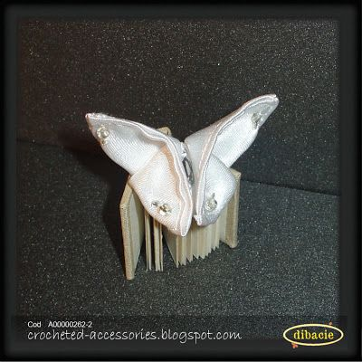 origami butterfly with beads on a handmade minibook (for my fashion dolls :D )