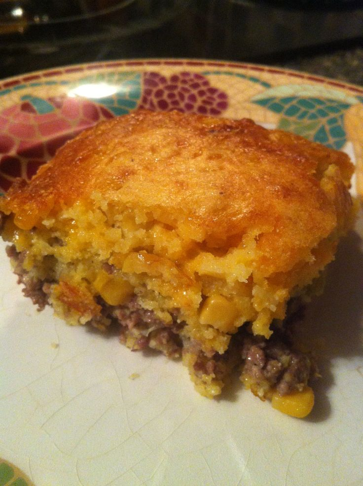 Mexican Cornbread | -1lb ground beef  -1 chopped onion (or I just used onion powder)  -1 cup corn meal  -1 cup milk  -3/4 teaspoon salt  -1 can creamy corn  -2 eggs  -1/2 cup vegetable oil  -1/2 teaspoon baking soda  -1 4oz can green chilis**  -2 cups (1 bag) of shredded cheddar cheese