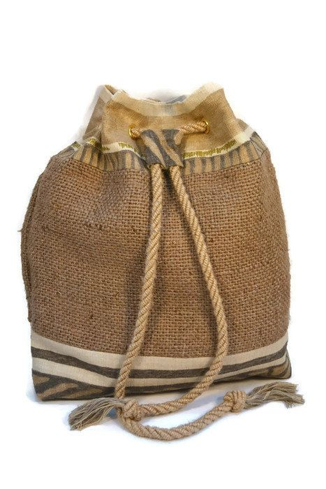 Unique hessian rucksack.  Handmade using recycled/upcycled materials, hessian (jute) and preloved fabrics.  Eco chic, unique accessory.  Handmade item Materials: Hessian from recycled coffee sacks, Preloved upcycled fabric, Lined with cotton fabric, Soft jute cord handles, Metal zip closure on inside pocket.