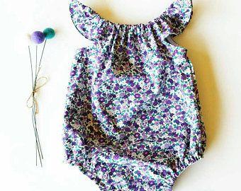 Purple flutter sleeve romper from @eliseandeverly