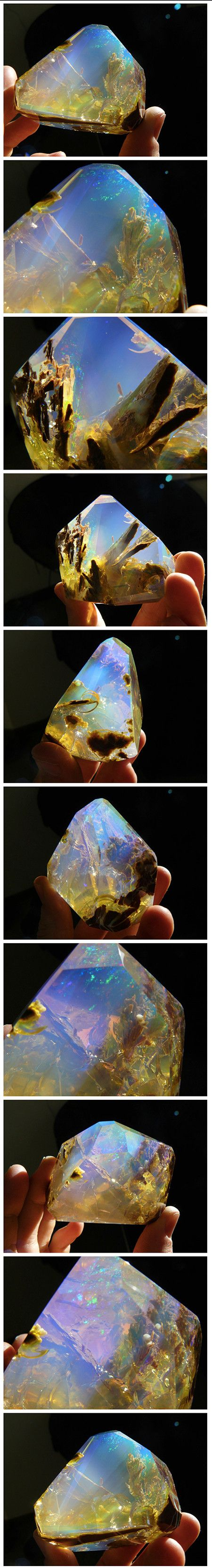 Crystals and gems are revered and collected for their physical beauty and monetary value and this Opal Butte crystal with contra luz color is no exception. The stunning gemstone, like many opals, features a varied spectrum of colors, but what separates it from the others is its spectacular visual effect. It looks like an underwater view of the ocean floor as light shines through it. There's a surreal quality about the gemstone that looks like a pocket-sized aquarium.