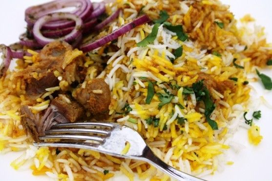 Lamb Biryani cooked with saffron, butter, and whole spices