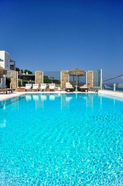 2 Bedroom Apartment in Ornos to rent from £1295 pw, with a shared swimming pool. With jacuzzi, balcony/terrace and TV.