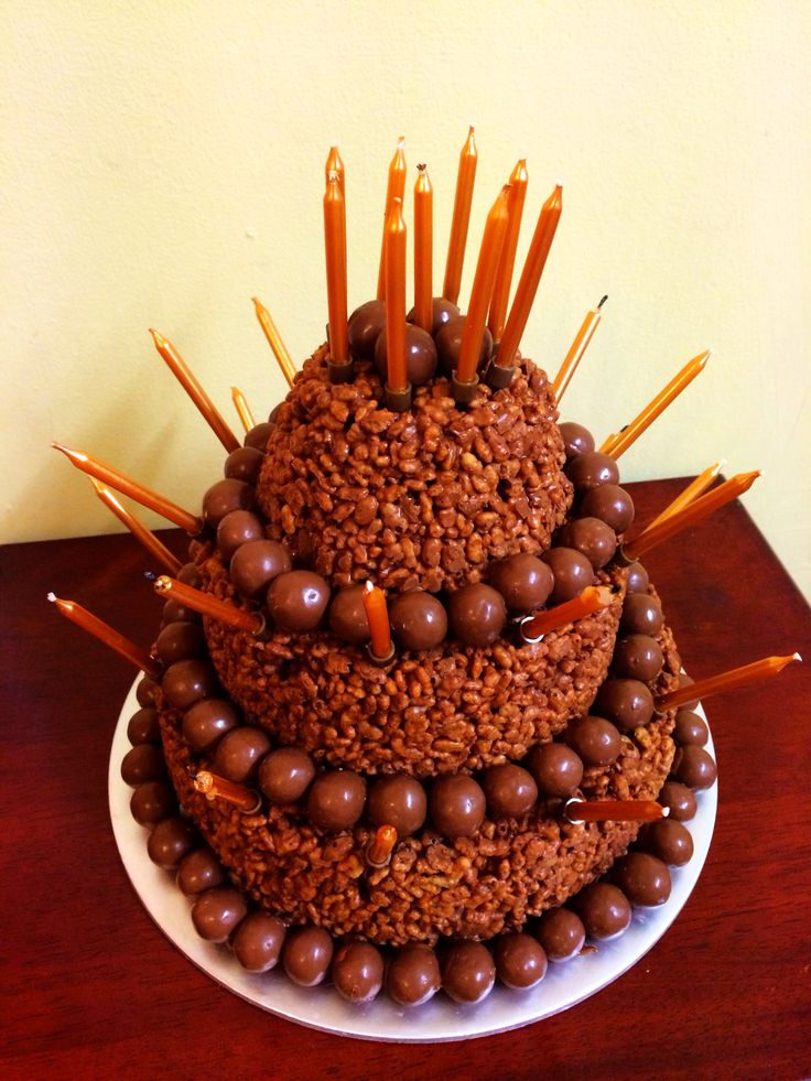 Tiered Rice Krispie birthday cake. Milk chocolate & maltesers.