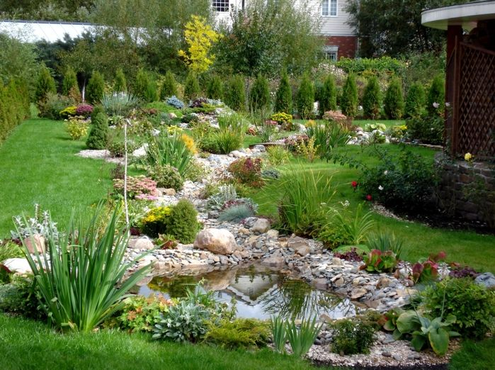 large trailing dry creek through the backyard serves as a decorative rock garden