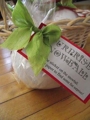 Surprise snowball -- really cute for a stocking.  Small trinkets wrapped up in white crepe paper to create a snowball