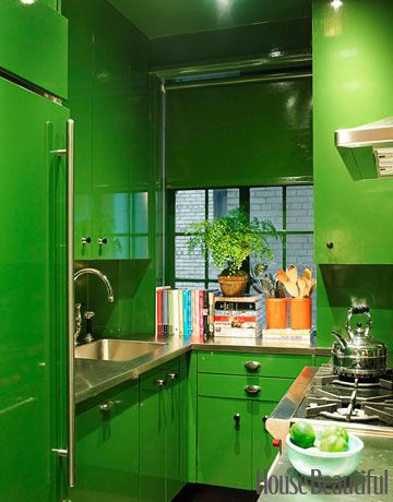 Small, Green Kitchen  In this small colorful kitchen, cabinets are lacquered in Bamboo Leaf by Fine Paints of Europe, as was the roller shade by Manhattan Shades & Glass, which erases an exhaust unit.