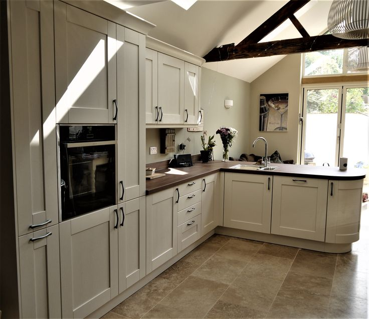 Contrasting shades of light and dark, with a painted Ash effect kitchen and deep wood tones in the laminate worktop, create a timeless country elegance.  Designed with a bespoke flush fit sink, which is unique in laminate worktops, and built in NEFF appliances to make cooking a pleasure.  #modern #country #kitchen #cream #beautiful  #wood #neff #yorkshire #ash