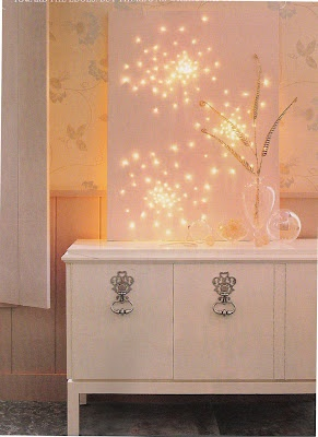 a great way to use mini-lights indoors without resembling a college dorm room! Blueprint editors took a basic art store canvas and painted it a pale pink, then poked tiny holes through which they placed the tip of the mini-bulbs! (Be sure no cords are in sight.)