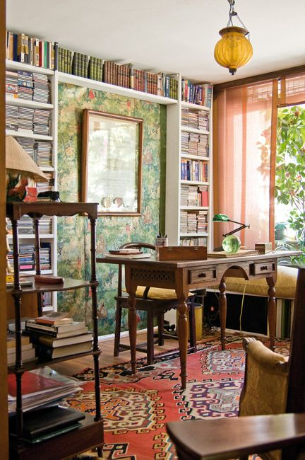 Orange oriental rug, green wall covering, framed by bookshelves. Imaginative. http://blog.asmarainc.com/blog