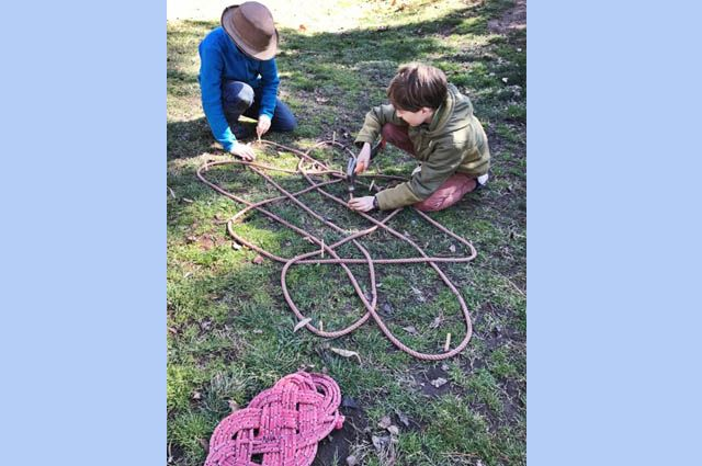 """What a great day to be outside learning. Class 5 are learning how to knot a """"senate template""""."""