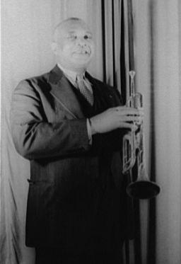 """William Christopher Handy was an American blues composer and musician. He was widely known as the """"Father of the Blues"""".  Handy remains among the most influential of American songwriters. Though he was one of many musicians who played the distinctively American form of music known as the blues, he is credited with giving it its contemporary form."""