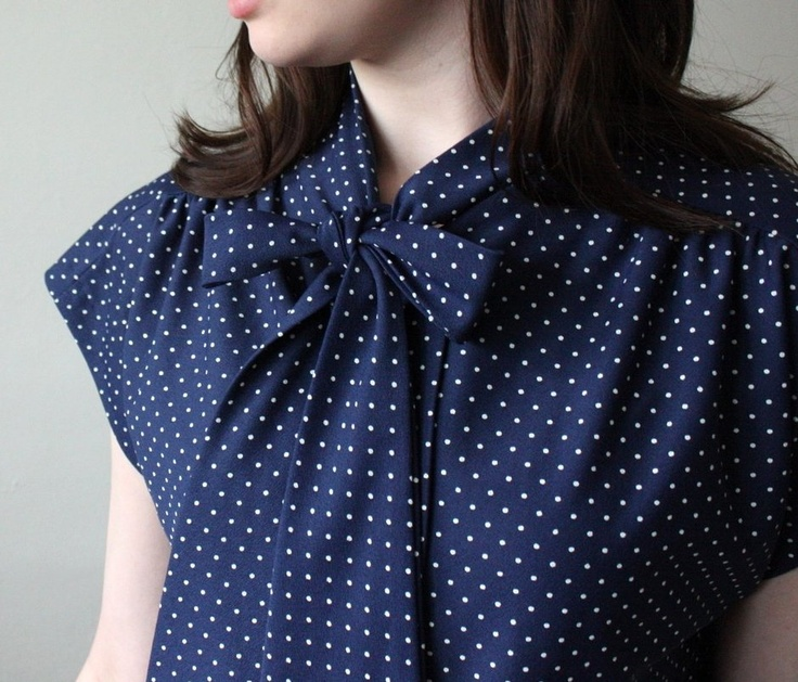 Navy bowed blouse with white polka dots. I like the vintage feel of this image from Etsy. I just need to keep my kids from trying to poke me when I wear it. The poke-a-dot joke isn't funny guys! Added thanks to Nate Berkus 8 makes 30, though he had it in black.