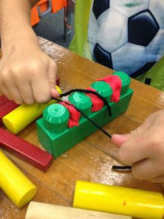 Teeth Health week in pre-k... practice flossing by getting play-doh out of megabloks using yarn!