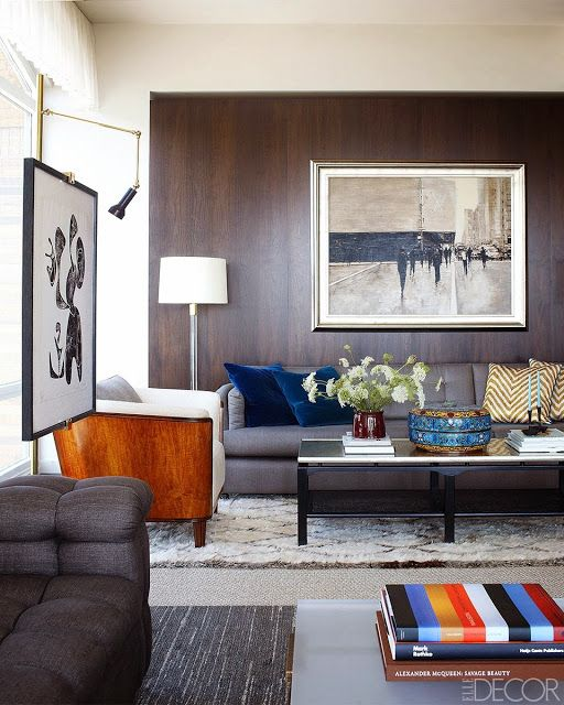 Apartamento En Manhattan. Con paredes revestidas de madera como recurso ornamental