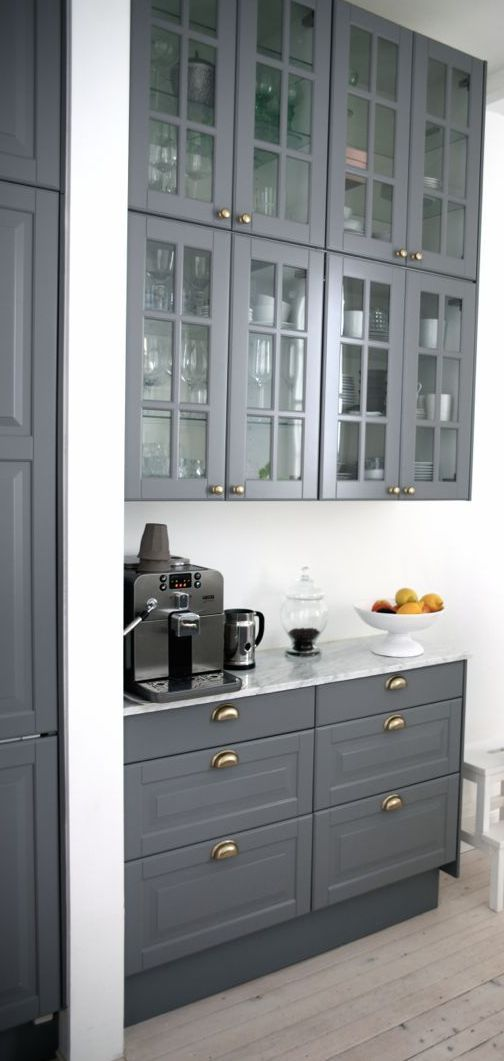 Rich gray cabinets with gold hardware