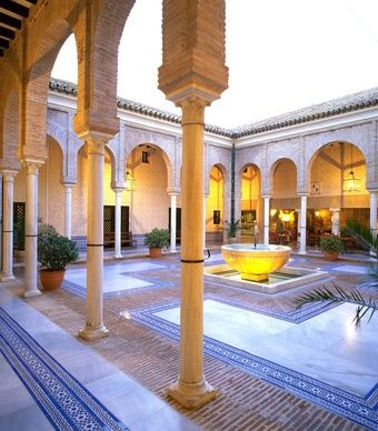 Inside the Parador de Carmona, a graceful Moorish courtyard with vaults and columns combines with antique Spanish furnishings to create a four-star experience reminiscent of times gone by. (From: 10 Beautiful Castle Hotels).