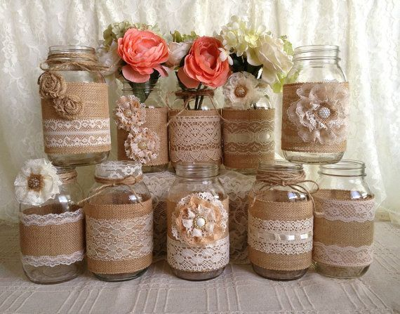 10x rustic burlap and lace covered mason jar vases wedding decoration, bridal shower, engagement, anniversary party decor  I made this adorable vases with natural color burlap and ivory, light beige color laces, handmade burlap and lace flowers, plastic buttons, twin bows. jars size: 32 OZ 3.78 x 7.0 (Flowers NOT included)  PLEASE NOTE: some of my laces out of stock but you will receive very similar jar set.  After i receive payment, please EXPECT approximately 2 to 3 WEEKS for your item to…