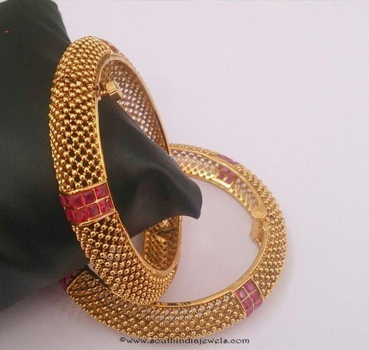 Stylish designer 1 gram gold bangles studded with semi precious rubies. For inquiries please contact the seller below. Seller Name   : 1 Gram Jewellery Contact No    :  9845476270 Website         : http://www.1gramjewellery.com/ Email            : 1gramfashionjewellery@gmail.com Address        : Shubham jewellers #871,nagarthpet main road Chickpet Bangalore, India More CollectionsOne Gram Gold AD BangleOne Gram Gold Pearl Cluster