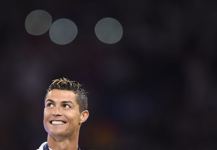 Real Madrid's Portuguese striker Cristiano Ronaldo celebrates after Real Madrid won the UEFA Champions League final football match between Juventus and Real Madrid at The Principality Stadium in Cardiff, south Wales, on June 3, 2017. / AFP PHOTO / Filippo MONTEFORTE