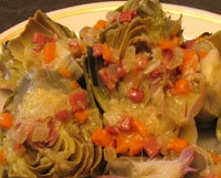 Alcachofas con Jamon - Artichokes with Serrano Ham  If you can't get Serrano Ham, Prosciutto lr thinly sliced Smithfield Ham would work.  And so would bacon, tho the flavor would not be quite as delicate
