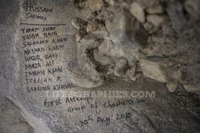 Signs on a stone with expedition team for Chashkin Sar peak 6.400m. Karakoram Mountains
