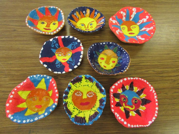 """Mexican sun bowls made of terra cotta clay by my 3rd grade students; approx. 5""""---7"""" diameter; lesson by art teacher: Susan Joe"""