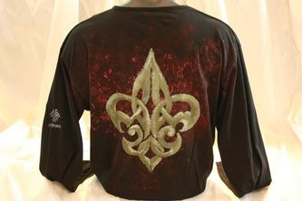 """Hand painted and hand stenciled men's t shirt, featuring the boy scout """"fleur de liés"""" design on the back. The colors are non-toxic, water based, permanent fabric colors."""