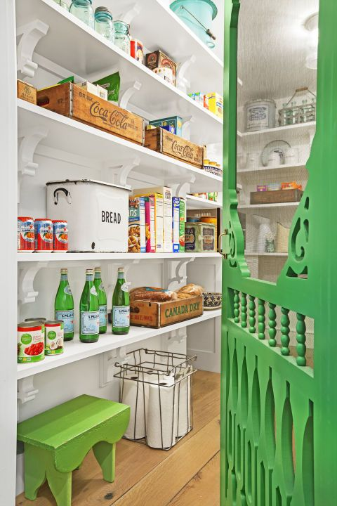 Pantry:  For the pantry, Alison painted a screen door from a big-box hardware store the same kelly green as the vintage breakfast table