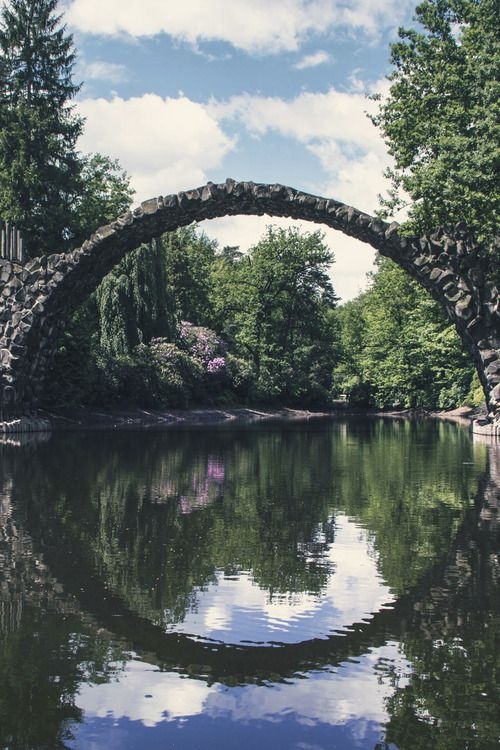 "The reflection of this amazing bridge in Germany creates a perfect circle, no matter where you're looking at it. Even more amazing? Rakotzbrücke, sometimes called ""devil's bridge,"" was built more than 150 years ago. #travel #travelbucketlist"