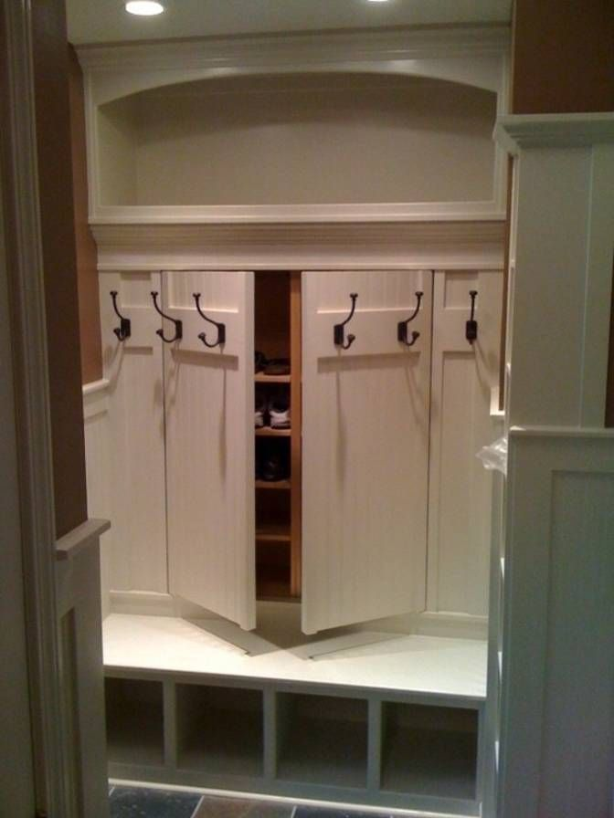 This mudroom has an ingenious built-in coat rack featuring a hidden shoe storage rack. As seen on Cute Decor.