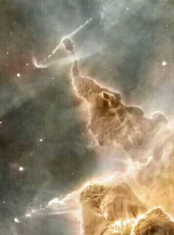 Dust Pillar of the Carina Nebula. Inside the head of this interstellar monster is a star that is slowly destroying it. The monster, actually an inanimate pillar of gas and dust, measures over a light year in length. The star, not itself visible through the opaque dust, is bursting out partly by ejecting energetic beams of particles. Similar epic battles are being waged all over the star forming Carina Nebula NGC 3372.