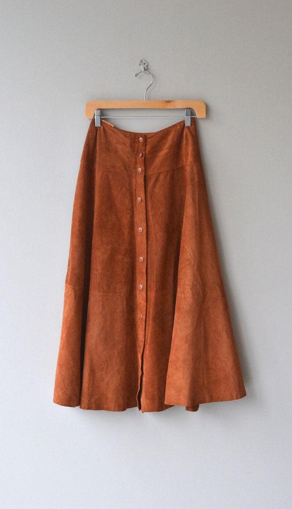 Vintage 1970s russet suede skirt with button front, aline shape, midi length and nylon lining.  --- M E A S U R E M E N T S ---  fits like: small