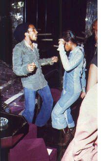 **Bob Marley** & Sandra Kong, Night Club 'Chez Regine', Paris, France, May 10, 1977. Party for Bob after the Paris Show at the Pavillon Baltard. More fantastic pictures, music and videos of *Robert Nesta Marley* on: https://de.pinterest.com/ReggaeHeart/