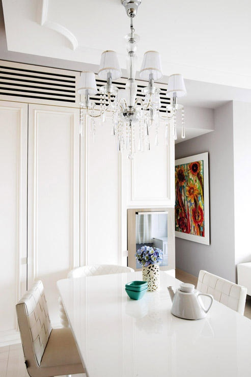 Full-height cabinets hide the dining ware, and also extend up to conceal the aircon unit behind the wooden-strip grating