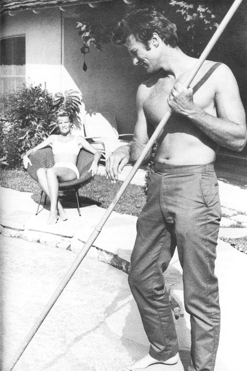 Clint Eastwood cleans his pool while his first wife, Maggie, looks on.
