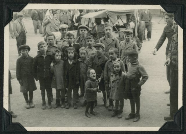 Group portrait of children in the Ziegenhain displaced persons camp.  Two members of the Frankfurt Jewish GI Council are on the far right.