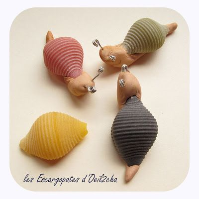 Make snails with colored pasta, clay and wire...too cute!  (The instructions to make these little escargot are in French, but the picture is pretty self explanatory)