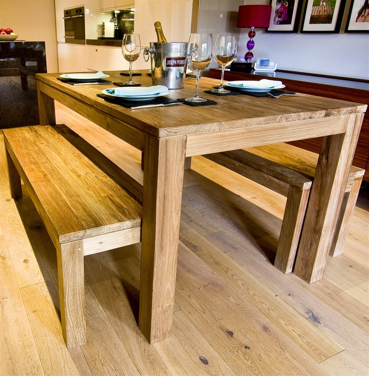 The 'Ekas' Dining Table – a beautiful and unique, solid wood dining table made from 100% eco-friendly solid reclaimed teak.