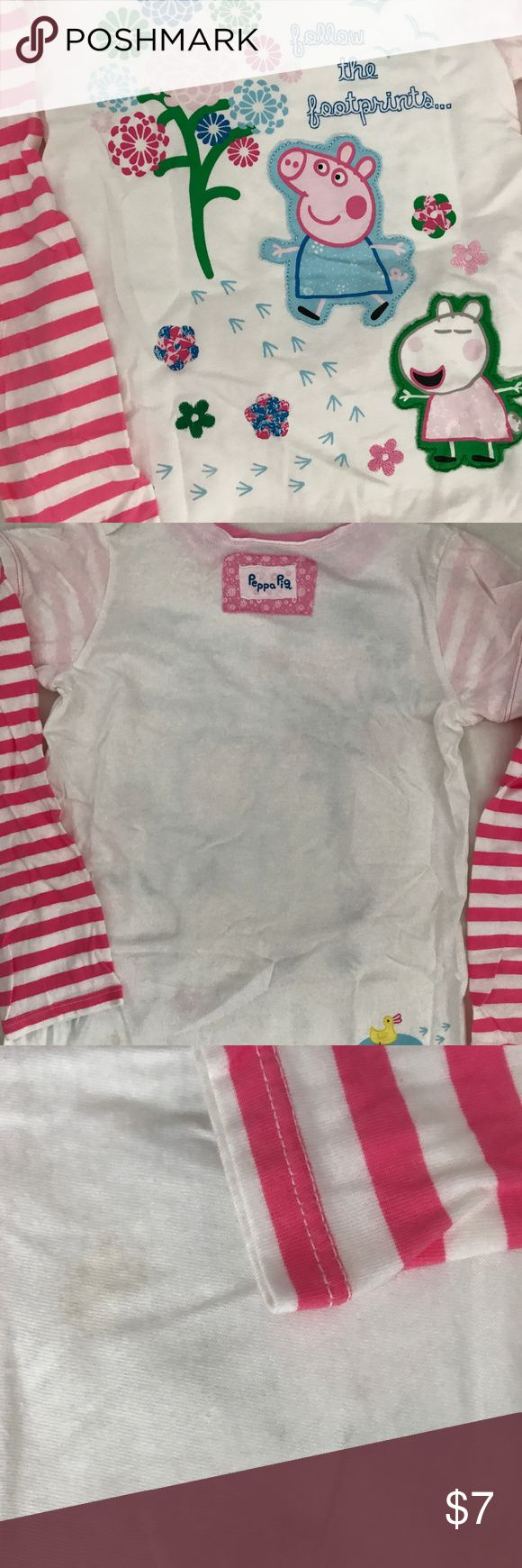 Peppa Pig applique shirt by Marks & Spencer 6 7 It's a short sleeve over long sleeve layered t-shirt.  The long sleeves are a bubblegum pink and white stripe.  It's printed with flowers, a tree and little footprints that lead around the shirt to a little duck.  There are appliques of Peppa & Suzy Sheep.  The size is 6-7.  It's in very good condition.  There is a tiny yellow dot on Peppa's ear, and there's a small stain on the inside of the back that slightly can be seen through the shirt…