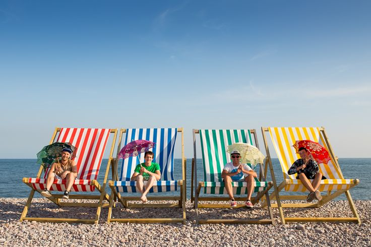 lads in giant deckchairs