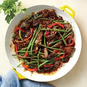 Cut costs at the supermarket by rethinking how you buy meats. Here, we use a less expensive cut of beef and stretch it by adding colorful fresh veggies to the entrée. Thinly slice the meat and stir-fry it quickly to keep it tender.