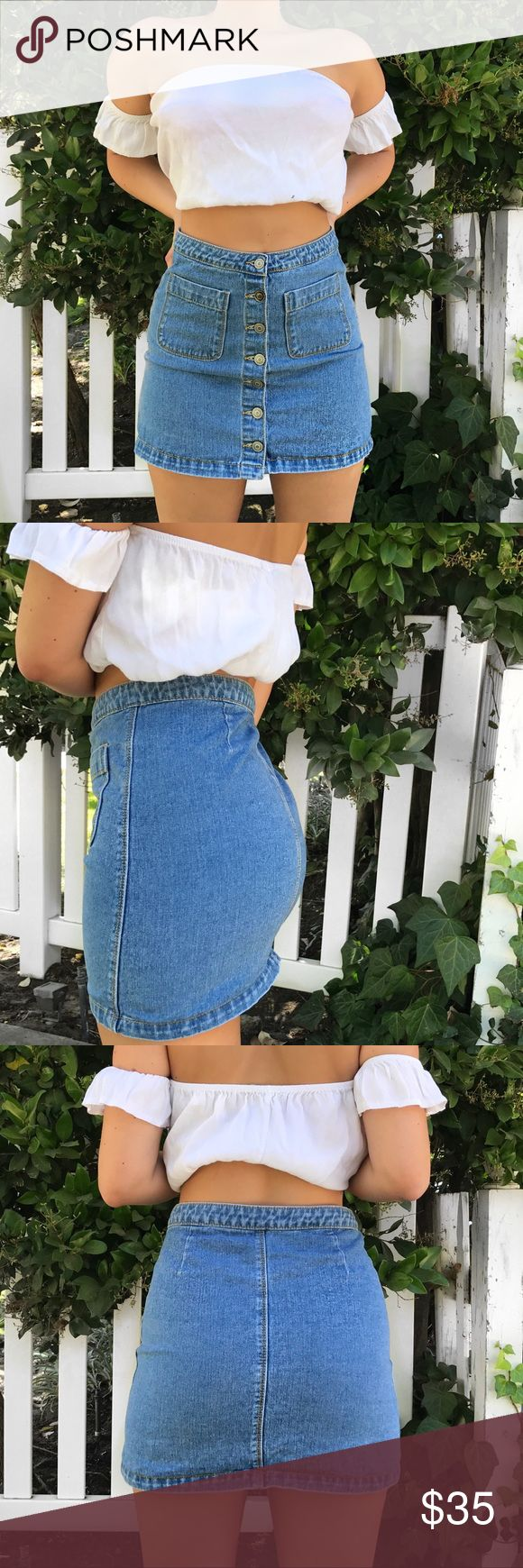 BRANDY MELVILLE SKIRT Brandy Melville denim button down skirt -- worn once -- perfect condition -- model is a size 26/medium -- skirt can fit size small to medium -- color true to photos Brandy Melville Skirts Mini