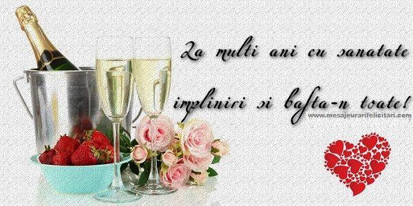 Felicitari de la multi ani cu flori si sampanie - La multi ani cu sanatate, impliniri si bafta-n toate!