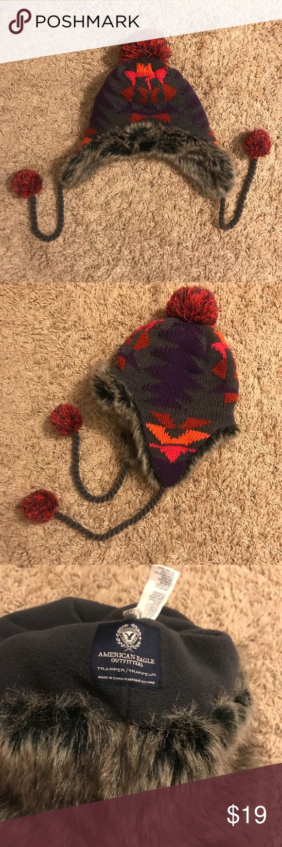 ❄️Like new American Eagle faux fur trapper hat❄️ Like new American Eagle trapper hat! Really cute grey- black faux fur and a cool pink, purple, orange, and red geometric knit design! The fur extends in a headband around the inside and the middle of the inside is fleece. Covers up your ears well so you'll stay warm❄️ Only worn twice! Comes from a smoke free home! American Eagle Outfitters Accessories Hats