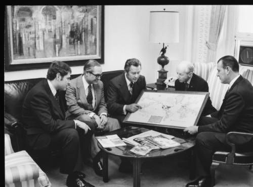 Herbert G. Klein and staff examining a map of world destinations :: Herbert G. Klein and staff examining a map of world destinations :: Herbert G. Klein Papers, 1940-2000. http://digitallibrary.usc.edu/cdm/ref/collection/p15799coll169/id/56