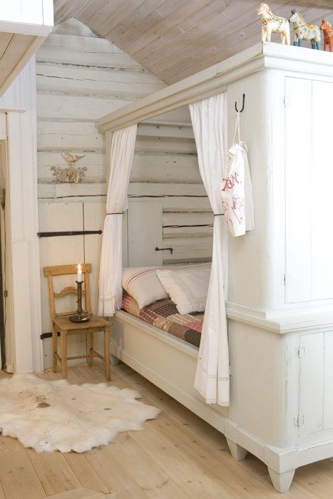 built in bed as piece of furniture with wardrobe at foot of bed. Love the hanging curtains so the child can close them for privacy or a fort / clubhouse feel